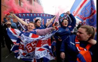 Rangers football fans defy pandemic restrictions to celebrate winning the  Scottish Premiership title outside the Ibrox Stadium in Glasgow, Scotland, yesterday.