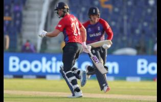 England's Dawid Malan (left) and teammate Jason Roy run between the wickets during the ICC Men's Twenty20 World Cup cricket match against Bangladesh in Abu Dhabi, UAE, yesterday. England continued their perfect start at the Men's T20 World Cup with an eight-wicket thrashing of Bangladesh. SCORES: Bangladesh 124-9 (20 overs): Tymal Mills 3-27, Liam Livingstone 2-15, Moeen Ali 2-18; England 126-2 (14.1 overs): Jason Roy 61 (38), Dawid Malan 28* (25).