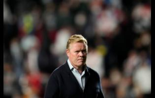 Barcelona's head coach Ronald Koeman heads back down the tunnel at half-time during the Spanish La Liga soccer match against Rayo Vallecano at the Vallecas stadium in Madrid, Spain, yesterday.